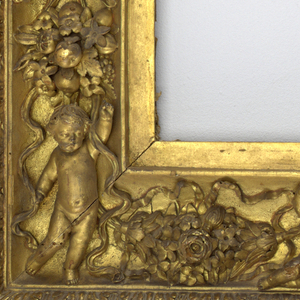 In seventeenth-century Spanish style, probably incorporating old frame elements. The upright rectangular form with putti and swags of floral bouquets surrounding the opening, the outer border with acanthus.