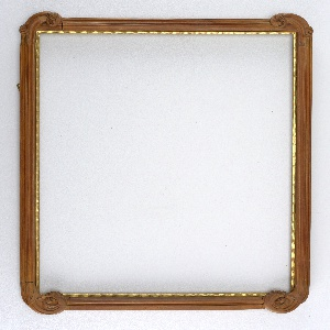 Vertical rectangle of natural wood with gilt rabbet. Intersecting grooved moulding on bottom and sides, ending in scrolls on four corners. Top smooth, with only one deep groove.