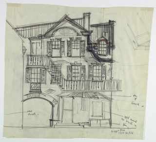 Horizontal rectangle. Ramshackle three story house with exterior stairs and balconies, shuttered windows.