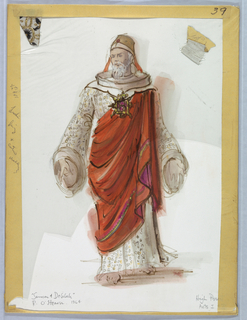 Vertical rectangle. Male figure in printed robe and orange toga, large gold pin on chest. Two fabric swatches attached.