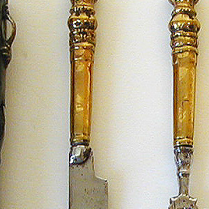 Fork has two long straight tines, decorated shoulders and neck.