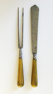 Fork has two straight two tines. Rounded shoulders, baluster-shaped neck plain brass handle, round in section.