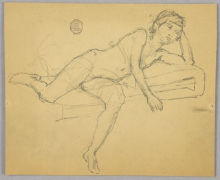 Nude boy reclining on a mattress, with left leg hanging. Left arm is bent, supporting head.