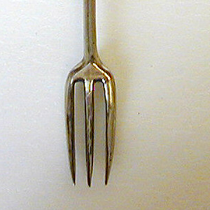 Fork has three short tines, curved shoulders, long baluster shaped neck. Silver ferrule with horizontal bands, plain silver band on the handle. Agate handle oval in section with rounded top, small metal mount on top.