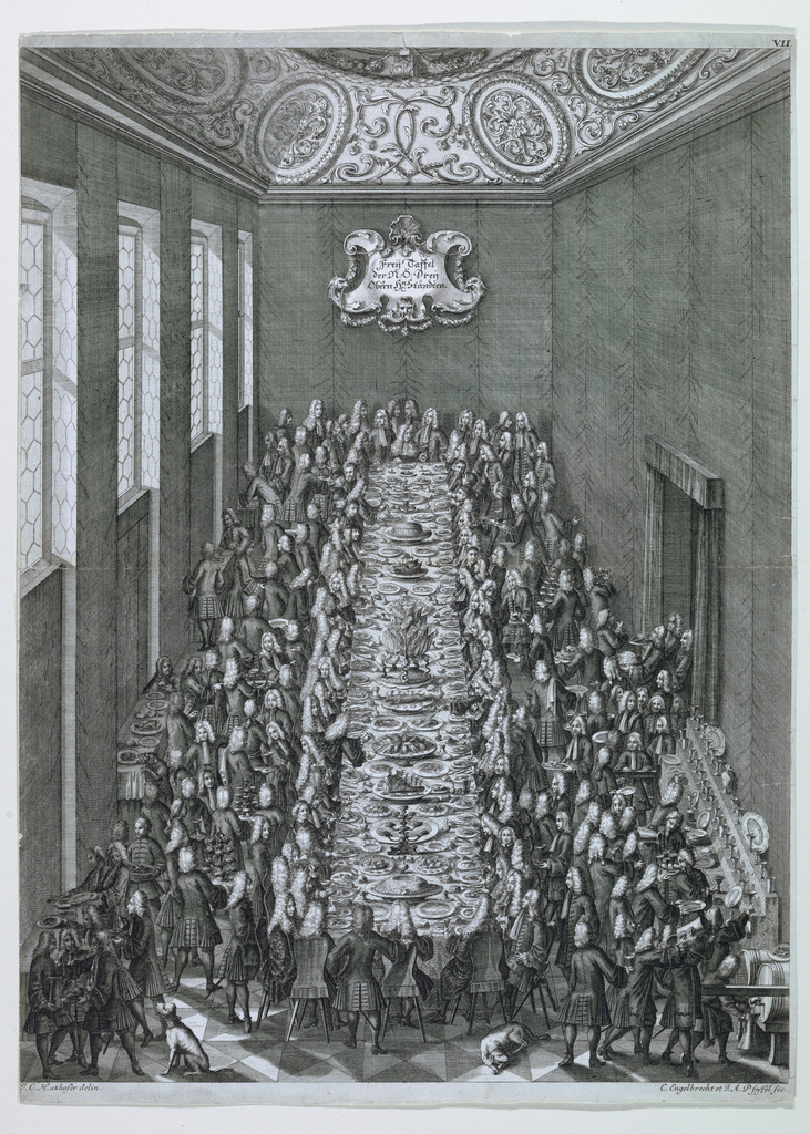 """A bird's-eye view into a high ceilinged room with honeycomb windows on the left and an ornately ornamental ceiling.  A table, set with all manner of dishes and food, extends the length of the room.  The be-wigged banquet guests surround the table while servants carrying food occupy most of the remaining floor space.  Escutcheon on rear wall reads:  """"Freij Taffel/der N.O. Dreij/Obern Hn [""""n' superscripted] Stäendten""""."""