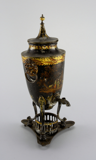 a) Urn-shaped coffee pot, on cabriole legs with flat, turned feet, faucet, ring handles held in lion-masks. B) flat lid with steeple finial. C) triangular stand with concave sides, with circular holder for heating arrangement, Black with landscape and other decorations in gilt and colors.