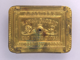 """Rectangular, curved corners, canted sides, with cover that slides off top of box; cover features beading on right and left edges, with thumb catch on right side, raised frame contains inscription """"J. Palmer's, Camberwell London""""; inscription inside frame reads """"Royal Patent, Wax Vesta Match""""; at center is small raised opening to hold single lit match, to left is image of lion, over opening is crown, to right is image of a horse; underside inscribed """"Alexander S. Stocker, Patentee"""" in upper recessed area, striker in central recess, """"Brass Battery Works, Wandsworth Surrey"""" inscribed in bottom recess."""