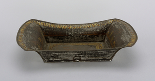 Rectangular flat bottom, outcurving sides. Black field, decorated on bottom with motif of oak leaves, on either end with rural scenes, and around upper edge with conventionalized lotus motif.
