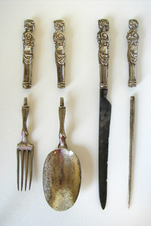 Fork has four curved tines, waisted neck ending in screw thread.
