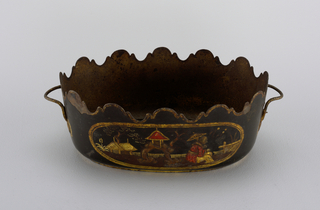 Oval, with shaped edge and simple handles. Black field, decorated in colors and gilding with Chinese figures, slightly raised.