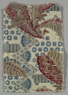 Silk fragment showing design of red and metallic flowers against a blue and white geometric background against a white horizontally ribbed ground.