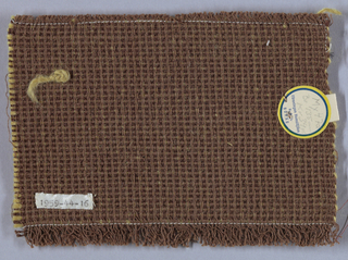 Warp is brown cotton and weft has alternate picks of brown wool and heavy yellow wool. A variation of plain weave in which warps are used four at a time, then dovetailed as five-floaters.