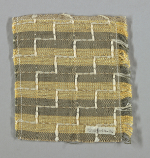 Stripes made by alternate bands of grey and yellow warps. Weft throughout is light brown. Regular stepped pattern is made by bunches of white yarn woven by free shuttle both vertically and horizontally to float on front or back as pattern requires.