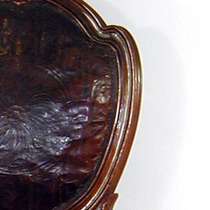 Back is an interrupted oval, carved at top with small leaf forms; back supported by two leaf sockets.  Shapted seat, front rail serpentine.  All legs turned, straight, tapered, and fluted.  Rosettes at knees.