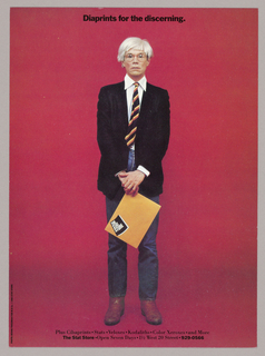 A full length color photograph of the artist, Andy Warhol (1928-1987), is centered on the page on a dark red background with a smoky overlay, thickest behind the subject's lower legs. The artist's eyes stare straight ahead through large-lens, possibly clear-rimmed glasses. His straight white-blond, wigged, choppy-style hair is brushed to the left, where it is longer than on the right. His lips are slightly parted and turned down at the corners. The effect of the overall expression is vacant, even stupefied. His arms, posed in front, end in his left hand covering the right. He wears a white collared shirt under a black unbuttoned blazer. The shirt collar escapes the jacket and the shirt cuffs are visible, more so above the upper hand than the lower. A black-orange-and-yellow striped tie, knotted but askew, ends just above straight-legged, baggy-kneed jeans. The artist stands with his legs straight but apart; he wears tan, scuffed leather boots. His right hand grasps a manila envelope by one corner. The envelope slants downward to the left and is imprinted with the client's logo: The/ Stat/ Store in bold white sans serif type on a diagonally placed rectangular black field with concave upper and lower edges;    the lines of type emulate the curves. The rectangle is shadowed in gray on the right and lower edges, as if the pages of a book were being riffled.  Just below the top edge of the page, centered above the image, Diaprints for the discerning is imprinted in dark sans serif type. Two additional lines of type about The Stat Store are centered just above the lower edge of the page. The photographer, Benno Friedman; M&Co; and The Stat Store are credited in one line of type imprinted along the left-hand edge near the bottom.