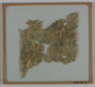 Fragment with green warp and yellow weft in a design of pairs of falcon-like birds and smaller birds in double ogival frame. Arrangement has the smaller birds betweens the ogives framing larger birds. Stylized tree form between birds. Ogives ornamented with zigzag.