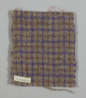 Sample of brown and purple textured plaid.
