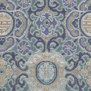Allover geometrical design in rose and blue on light blue ground.