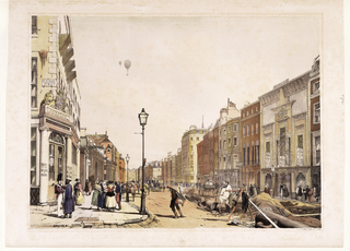 Street scene, Egyptian Hall at right, Patent Office on Old Bond Street at left.  Installation of water system is shown at right.  People looking up at two ballons in the sky.