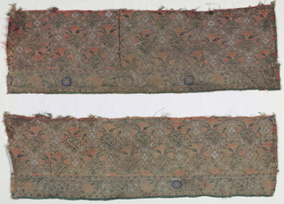Pattern of red flowers in ogival shaped latticework. Bottom border of flowers.