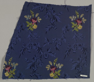 Sprays of small flowers in polychrome silk on a dark blue ribbed background.