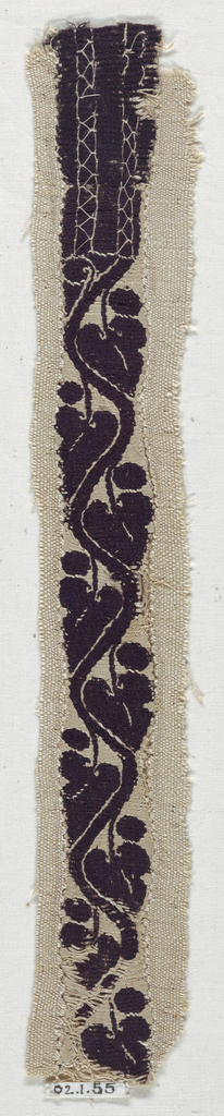 Long and narrow band of leaves on a serpentine vine, above a section with embroidered herring-bone stitches.