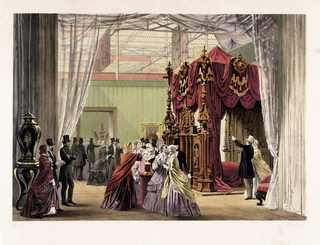 View of the installation of the Austrian Pavilion at the 1851 London Exposition. Image is dominated on the right by a large carved wooden bed with lush red hangings. Clusters of men and women are shown viewing exhibits.