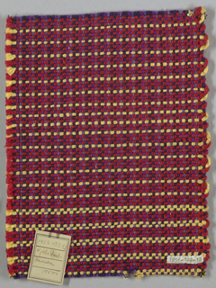 Firm fabric with fairly heavy yarns. Wool warp: two dark purple alternating with two in shades of light purple; weft: three red mercerized cotton, two light yellow.