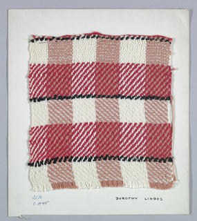 Horizontal, symmetrical 2/2 herringbone twill plaid with paired and unpaired warps. Warp has stripes of red four-ply cotton and white two-ply synthetic. Weft has bands of white boucle, black boucle, and red smooth yarn.