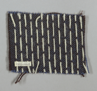 Black warp and blue weft. A single white lancé weft floats over two warps on surface to make simple pattern of white dots, widely spaced.