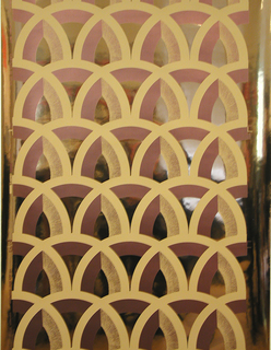 Repeating motif of pointed arches arranged in a fish-scale design.