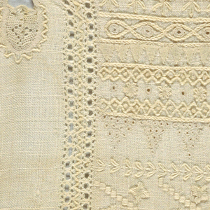 Whitework sampler with seven plackets and eight button holes.  Two separate samplers sewn together.