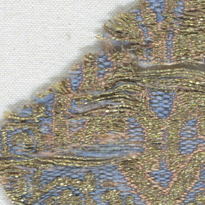 Eight-pointed stars enclosing rampant addorsed lions, heads turned toward each other; the pointed-armed crosses forming the interstices are filled with symmetrical foliate arabesques. The pattern appears slightly raised in gold on blue and pink ground.  Fragment from a set of vestments from the Cathedral of Lérida, Spain.