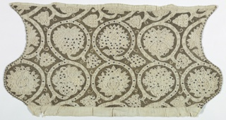 Woman's linen coif, opened flat, with a design of scrolling branches framing flower heads. The background is entirely worked in metallic gold thread, leaving the branches and flowers reserved in the white linen. The linen is worked in a variety of open-work stitches, and spotted with gold spangles.