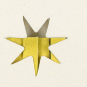Four white matchbooks feature an identical design of a seven-point star, incised in the center of the front cover. In one of the four (1993-151-92a), the star's edges are rough-cut; in the other three, they are clean. When the matchbook cover is closed, the match color, variously red (a and b), green (c), or yellow (d) may be viewed through the cutout star design. When the cover is open, a line of type, Be Safe-Close Cover Before Striking, is visible at the bottom edge. On the inside front cover, China Grill/ New York City (above the star) and the restaurant's telephone number (below the star) are imprinted, centered.