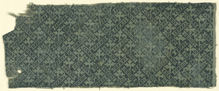 Pattern of leaves and diagonal bars block printed in black (now faded) on cloth previously dyed blue-green.