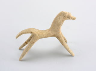Horse with four legs bowed slightly inward while tail has convex curve. Object has been repaired but still shows signs of chipping and hairline cracks.