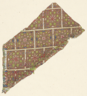 Fragment of woven silk with a design of off-set squares, each containing a rosette or star in brilliant blue, green, red and gold, on an ivory ground. Part of the Cope of San Valero, formerly in the Cathedral of Lérida, Spain.