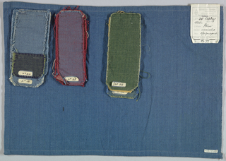 Thirteen swatches of Abbey Cloth in delft blue. Some with single, some with paired warps and wefts.