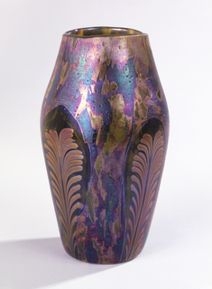 "Blown ""Cypriote"" ware vase with curved shoulder. Neck tapered inward toward plain rim. Lustred in overall mottled iridescent pattern, with four oval reserve panels with lustre applied to suggest upright feather motif."