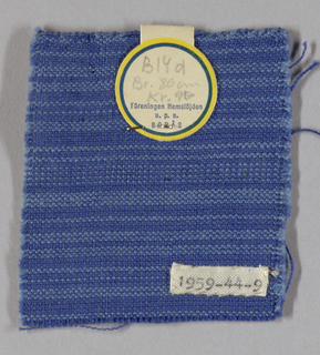 Warps in two shades of blue with darker blue wefts creates striped effect.