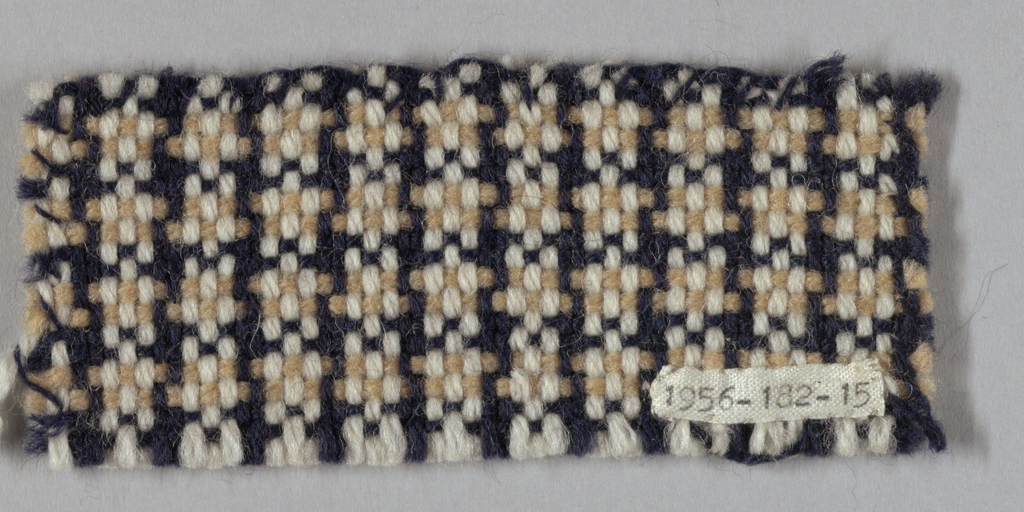 Firm coarse fabric with houndstooth check. Warp: two beige, two dark blue; weft: three white, two blue.