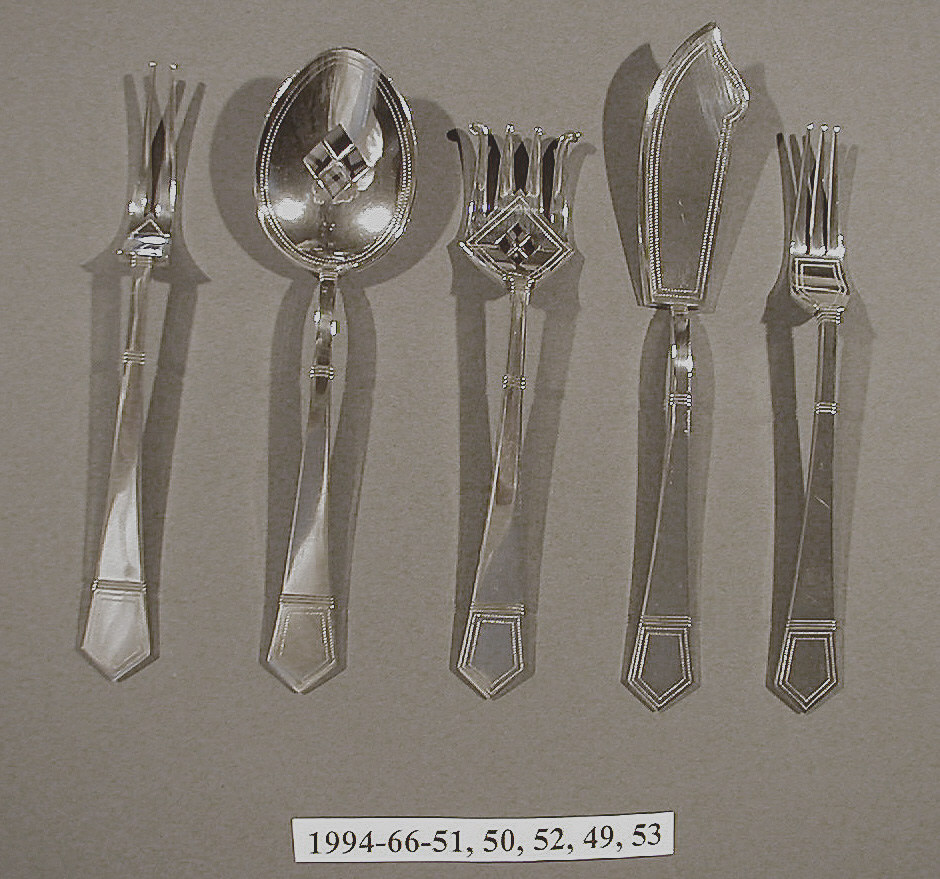 Four tines with outer two curving outwards and bowl formed as diamond with interected diamond cut-out in center and outlined by double row of stippling. Join with three horizontal bands, straight shaft (with three horizontal bands) widening to form handle with three horizontal lines and pointed end with double stippled pentagonal outline.