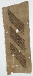 Diagonal bands of brown silk in geometric pattern. One selvage present.