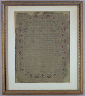 Embroidered in cross stitch in green, red and yellow on natural linen.  Verse in praise of King Charles I, with running vine border with red flowers.