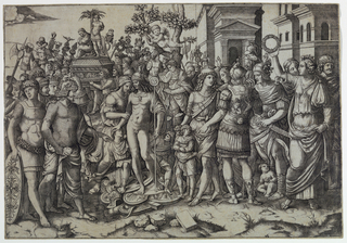 Slightly off-center and to the left stands Titus surrounded by a crowd. He wears a helmet and a drapery around his shoulders. In background, two buildings.