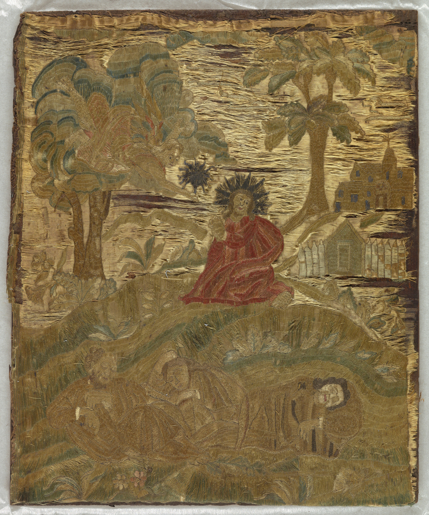"""Rectangular embroidered picture showing Christ praying in the Garden of Gethsemane on the eve of his crucifixion. Three apostles asleep in foreground, an angel hovers above kneeling Christ in middle ground. Trees and buildings in background. Multi color silk and metallic yarns on cream silk plain weave foundation fabric. Note attached: """"Mercur sale: From old English embroidered picture - Christ in background."""" Not in Fraser photo album. Very poor condition. Foundation fabric practically gone. Glued to a wooden board as received."""