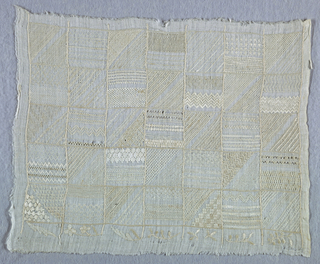 Rectangle of fine linen divided by chain stitch into thirty-five small squares, inside each of which a variety of drawnwork and darning methods are worked in white cotton.