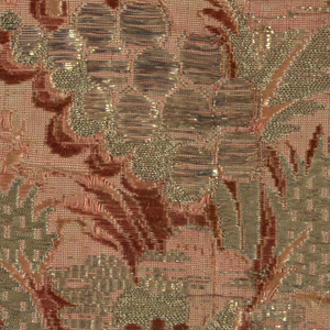 Red-orange ground with an incomplete spray of a flower and decorative foliage with brocading in two shades of red and flat metallic strips, metallic thread and metallic frisé thread.
