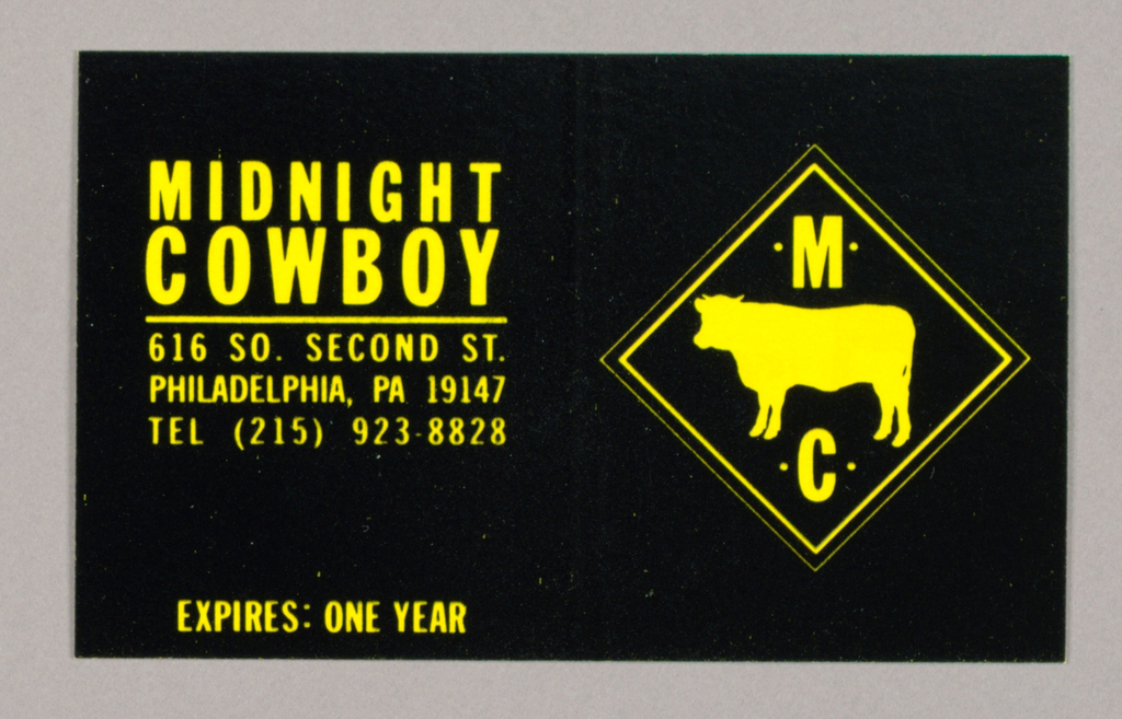 1993-151-237a - Letterhead - The Midnight Cowboy design color scheme is composed in black ink on yellow paper. A logo centered at the top of the page features a silhouetted steer in the center, placed between the letter M on top and the letter C on bottom, both surrounded by a pinpoint dot on each side; the whole is enclosed within a double-bordered diamond shape. Aligned with the logo, just above the bottom edge, Midnight/ Cowboy, imprinted in sans serif style capitals, is followed underneath by three lines of the address and telephone number and a final line, A Division of Marabbedan, Inc.  1993-151-237b - Envelope - In the top left hand corner, Midnight Cowboy, underscored by a thin line, is imprinted in the same font as on the letterhead. The upper point of the logo's border intersects this line. On the bottom left, the two line address is aligned with the center of the logo.  1993-151-237c - Label - A larger version of the diagonally shaped logo features the steer, centered between Midnight and Cowboy, which is followed beneath by the address on three lines. The whole is enclosed within a single border, thicker than in the letterhead version.  1993-151-237d - Business card - On coated cardboard, the design, positioned vertically and occupying the whole space, is composed of the letterhead logo, followed underneath by Midnight/ Cowboy, underscored by a thin line, with the three line address and telephone number beneath.  1993-151-237e - Gift Certificate -Recto: The color scheme is reversed, with yellow ink on coated black cardboard. The logo is centered top to bottom on the right; on the left, Midnight/ Cowboy, underscored, is followed underneath by the three line address and telephone number.